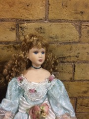 two_large_dolls_in_victorian_dress.