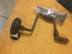 very old drill brace, with auger bits