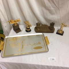 various shooting trophies, and presentation platter