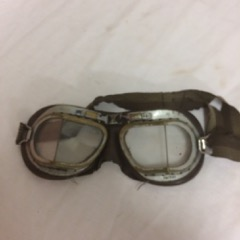 antique aviator goggles, split glass view.
