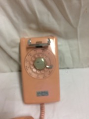 old_pink_wall_phone._rotary_dial