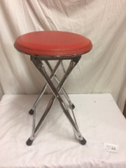 folding_stool,_steel_legs,_red_seat.