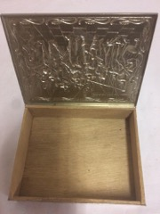 finely_decorated_cigar_box,_metal_overly_on_wood_box