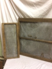 two wood framed wire mesh , rustic artwork