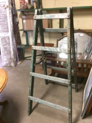 old heavy ladder, unique supports, green and paint