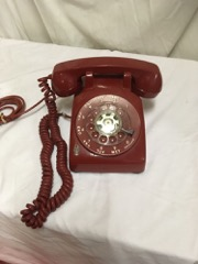 old_rotary_telephone_deep_red_color