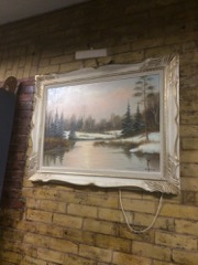 Large hanging picture, framed, with light