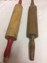 Two_old_dough_rollers,_red_handled