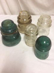 5_glass_insulators,_various_colours