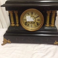 Antique ornate mantle clock.