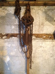 large heavy pulley system with chains.