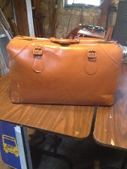 old brown leather luggage bag.