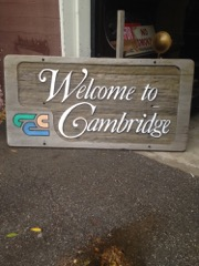 Wood welcome to CAmbridge sign.