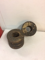 two_antique_pulleys_from_machines