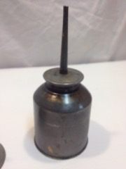 two_small_oil_cans_with_spouts.