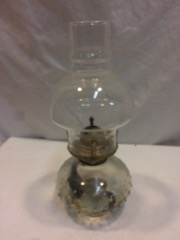 old oil or kerosene lamp with shade.