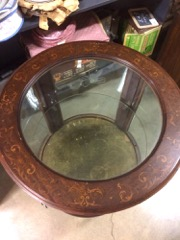 Round_display_table,_glass_shelf,_inlaid_designs