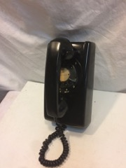 black northern telcom wall phone, dial