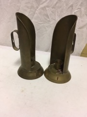 two brass candle stands, creepy